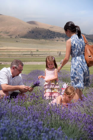 Family In Young Living Field